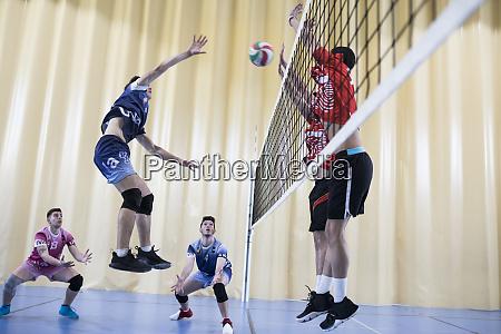 man jumping during a volleyball match