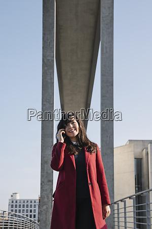 businesswoman standing near to modern building