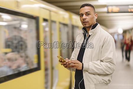 portrait of man at underground station