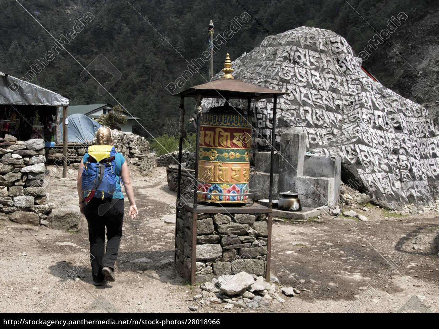 young, woman, walking, past, prayer, wheel, - 28018966