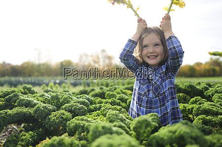 girl in a kali field leaves