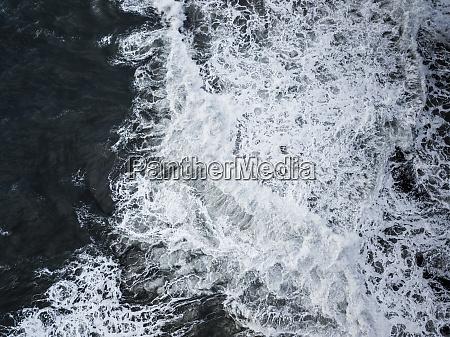 aerial view of splashing waves