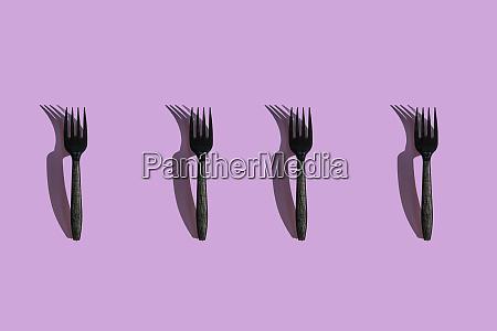 3d illustration of golden spoons on