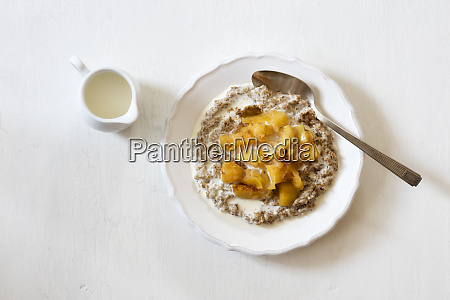 plate of rye porridge withquince compote