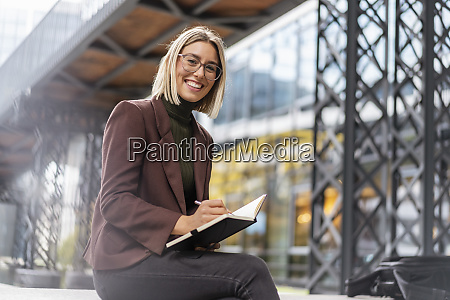 portrait of happy young businesswoman with