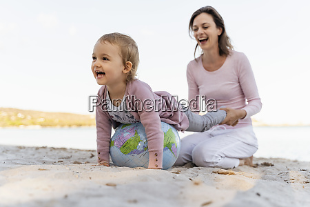 mother and little daughter playing together