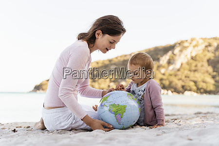 woman and little daughter sitting on