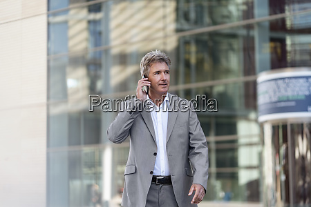 mature businessman on the phone in