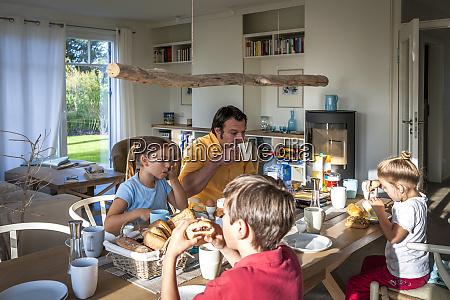 family having breakfast at dining table
