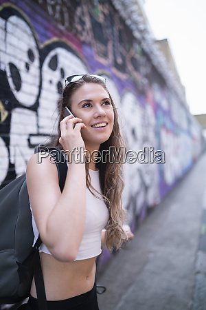smiling young woman on the phone