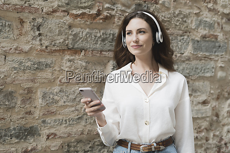 young woman with smartphone and headphones