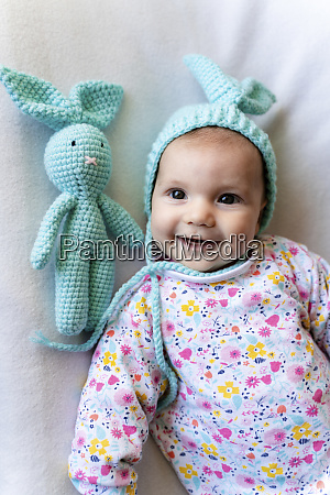 baby girl with bunny hat and