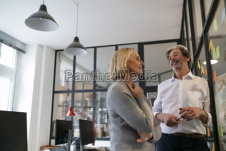 businessman and businesswoman working on sticky