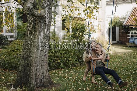 happy woman embracing senior man on