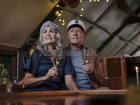 senior couple having a candlelight dinner