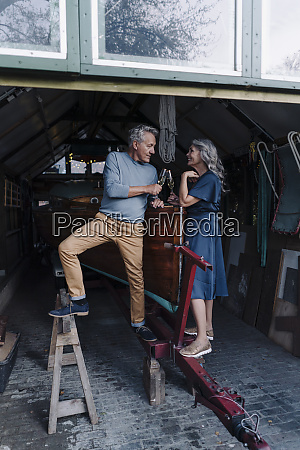 senior couple in a boathouse clinking