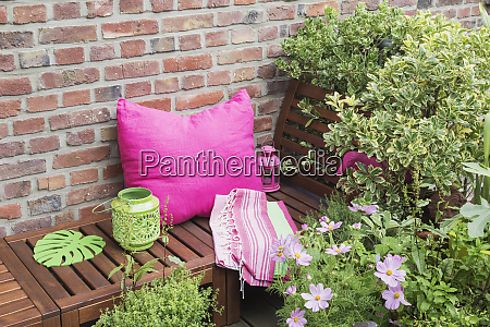 balcony with bench pink cushion blanket