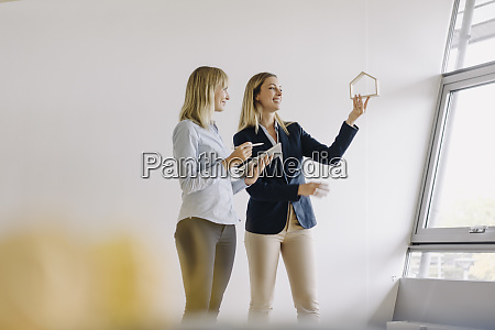 two young businesswomen with tablet and