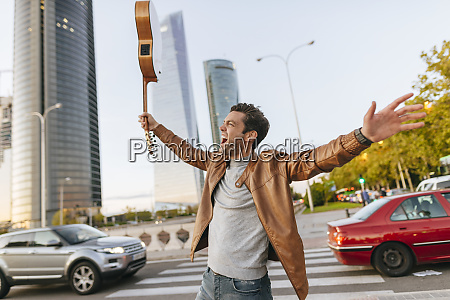 excited man with guitar in the