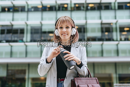 portrait of smiling woman with headphones