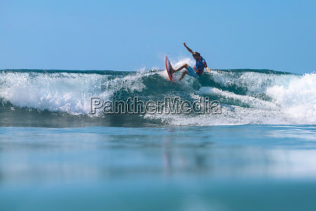 surfer on a wave bali island
