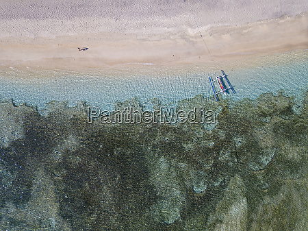 aerial view of outrigger moored at