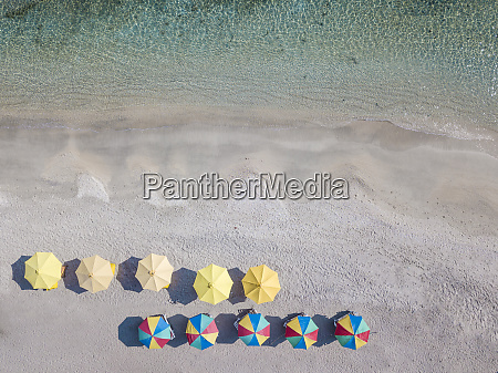 aerial view of colorful parasols arranged