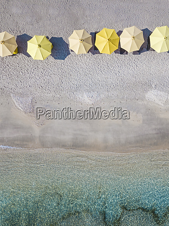 aerial view of yellow parasols arranged