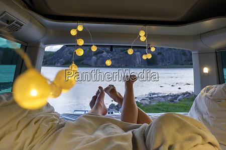 feet of teenage couple lying in