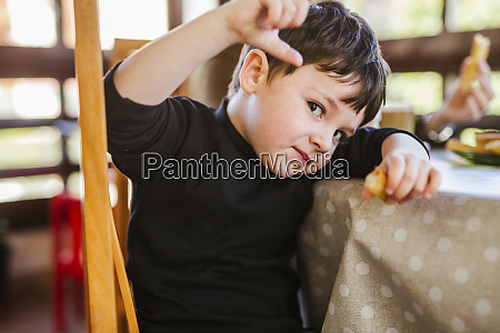 portrait of a boy eating churros