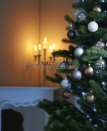 baubles hanging on christmas tree with