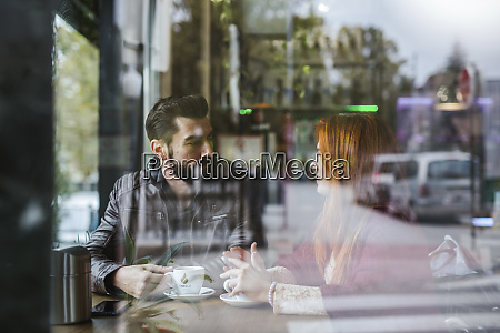 couple talking in a coffee shop