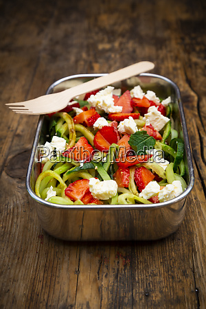 metal lunchbox with cucumber and strawberry