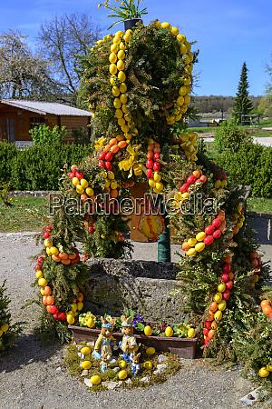 osterbrunnen against blue sky hollfeld germany