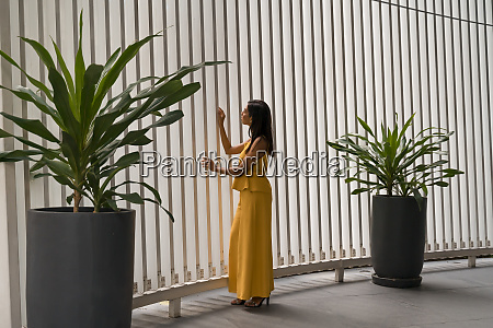 fashionable woman dressed in yellow