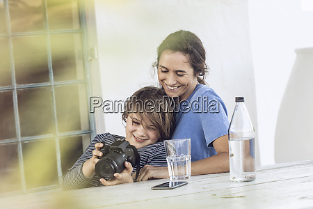 mother and daughter sitting at home