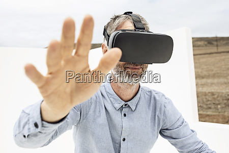 mature man wearing vr goggles