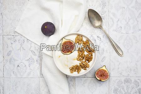bowl of greek yogurt with honey