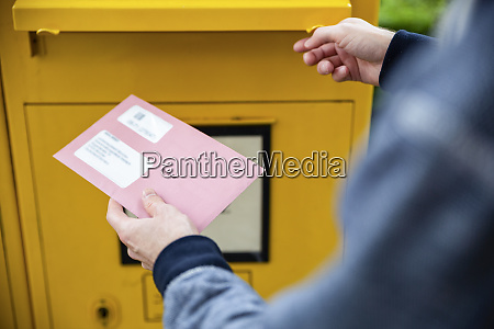 elector holding documtents for the postal