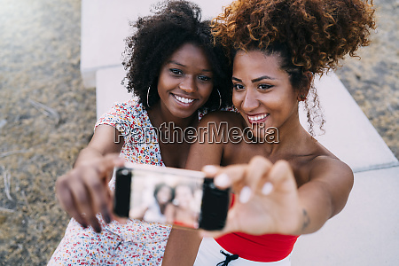 young women smiling and making a