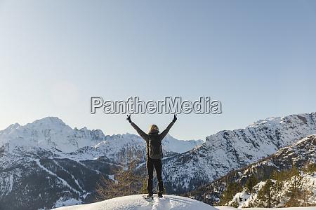 woman enjoying the winter mountain landscape