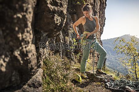 woman preparing to climb