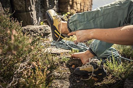 woman preparing to climb tying climbing