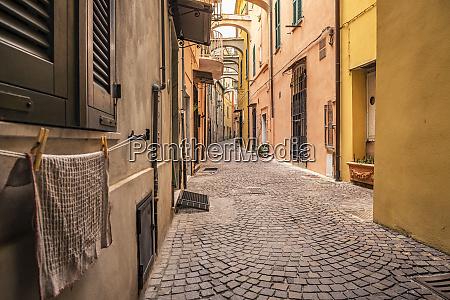 narrow alley in noli liguria italy