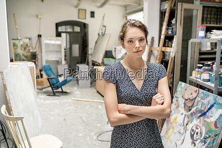 young artist standing in her studio