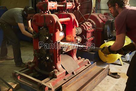 metal worker working in workshop