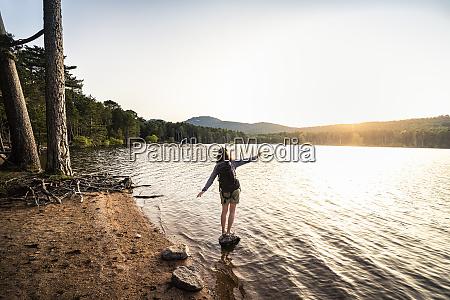 rear view of female hiker taking