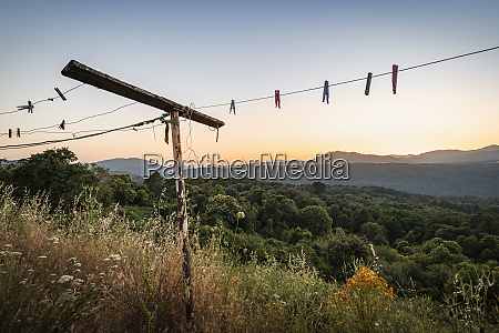old clotheshorse with clothespins at sunset