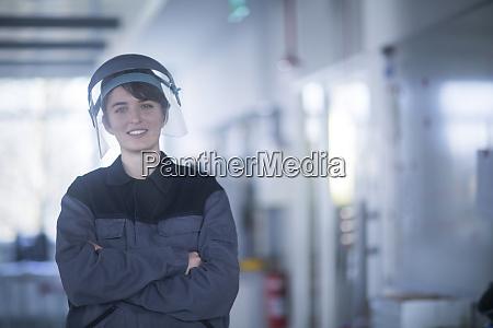 portrait of female technician wearing safety