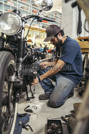 mechanic in a repair garage repairing